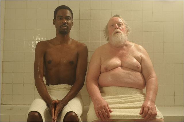 Photo de Chris Rock et Albert Delpy côte à côte dans un sauna dans le film 2 Days in New York de Julie Delpy.