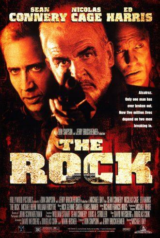 Affiche du film The Rock de Michael Bay sur laquelle nous découvrons les visages des trois personnages principaux incarnés par Sean Connery, Nicolas Cage et Ed Harris sur un montage photo.