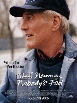 Affiche d'Un homme presque parfait. Il s'agit d'un portrait de Paul Newman souriant et regardant vers la droite.