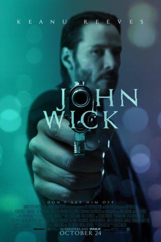 Affiche du film John Wick, sur laquelle nous voyons Keanu Reeves pointer une arme en plein vers l'objectif.