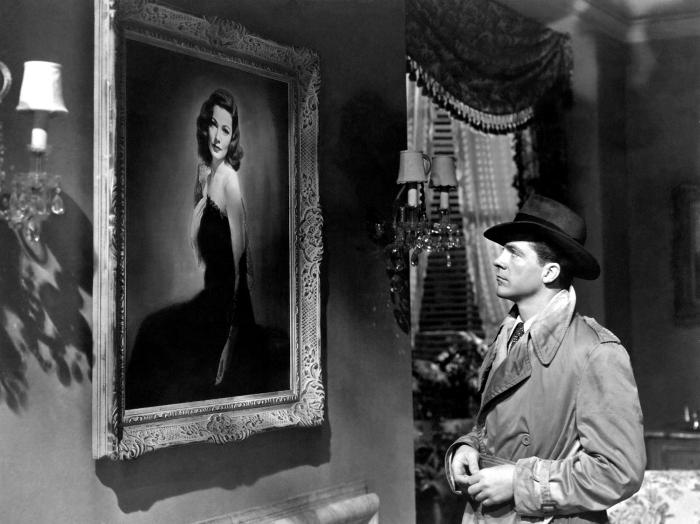 Photo de Dana Andrews observant un portrait de Laura, l'héroîne éponyme du film d'Otto Preminger incarnée par Gene Tierney.