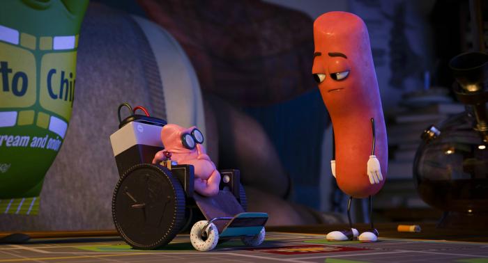 Photo tirée du film Sausage Party sur laquelle la saucisse doublée par Michael Cera discute avec un chewing gum en fauteuil roulant qui rappelle Stephen Hawking.