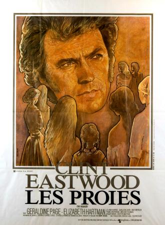Affiche de Les Proies de Don Siegel. Le visage de Clint Eastwood et plusieurs femmes de dos semblent s'approcher de lui.