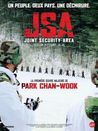 Affiche de JSA - Joint Security Area de Park Chan-wook sur laquelle des soldats sud-coréens se tiennent, armés, face à des militaires nord-coréens, dans la neige.