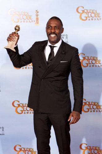 Photo d'Idris Elba récompensé aux Golden Globes 2012.