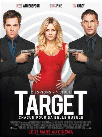 Affiche de Target de McG sur laquelle Reese Witherspoon se tient entre Chris Pine et Tom Hardy au milieu d'une cible. Ils sont tous deux armés.