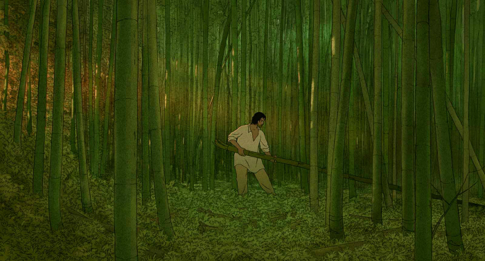 Photo de La Tortue Rouge, où l'homme est dans la forêt et tente de récupérer des branches de bambou.