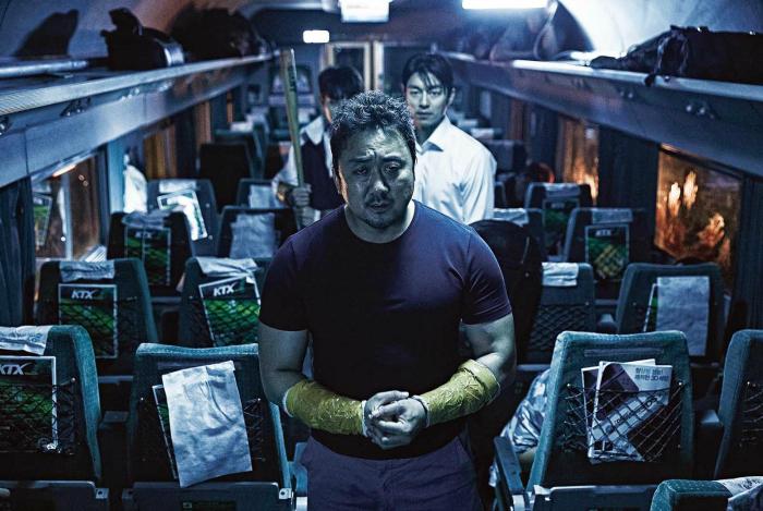 Photo des héros du film Dernier Train pour Busan sur laquelle les héros sont en route pour affronter des zombies.